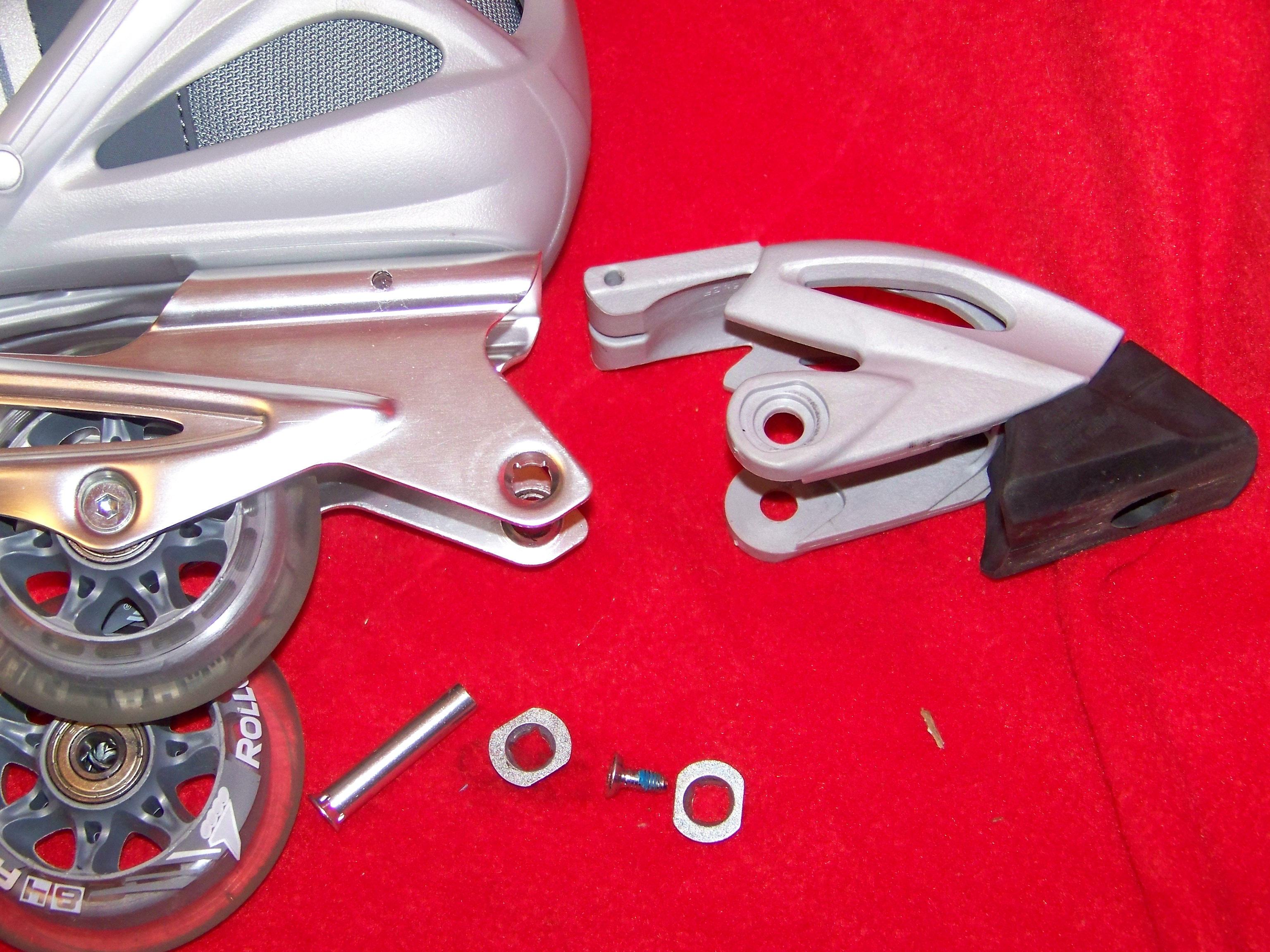 Right skate's disassembled brake and wheel hardware