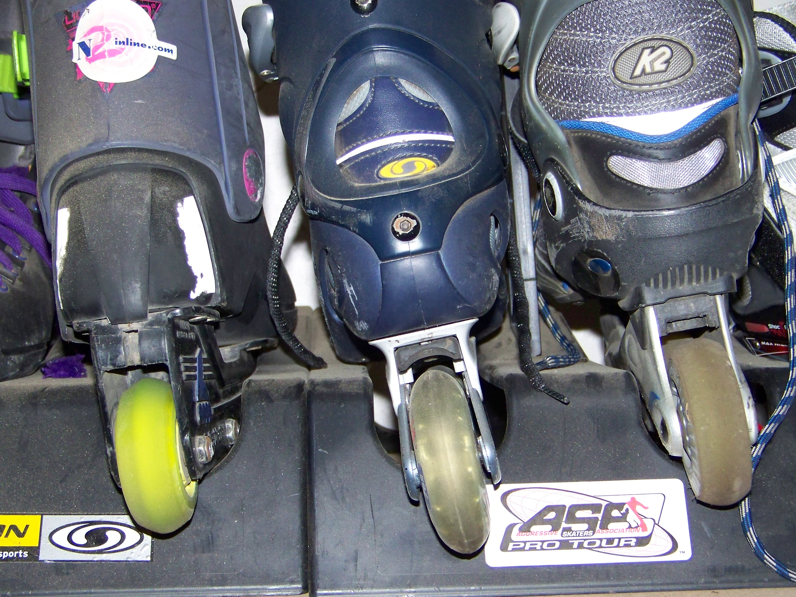 Rear view of Rollerblade, Salomon and K2 left skates showing mounting brackets