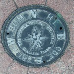 Manhole cover declaring Wallace, ID the center of the universe